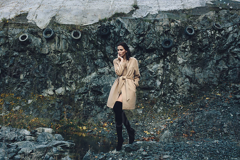 Beautiful girl in a stone quarry by Ania Boniecka for Stocksy United