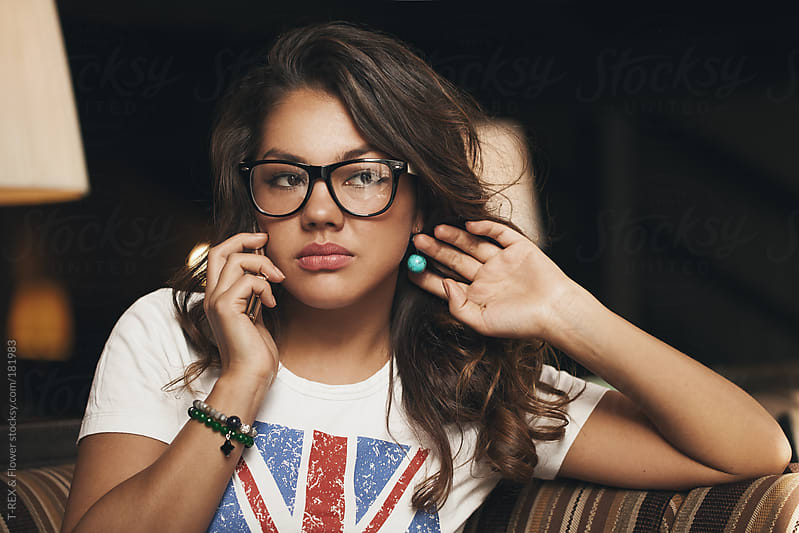 Young brunette in glasses making phone call by T-REX & Flower for Stocksy United