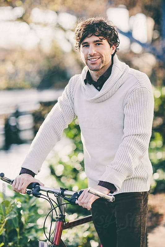 Stylish young man with bicycle by Suprijono Suharjoto for Stocksy United