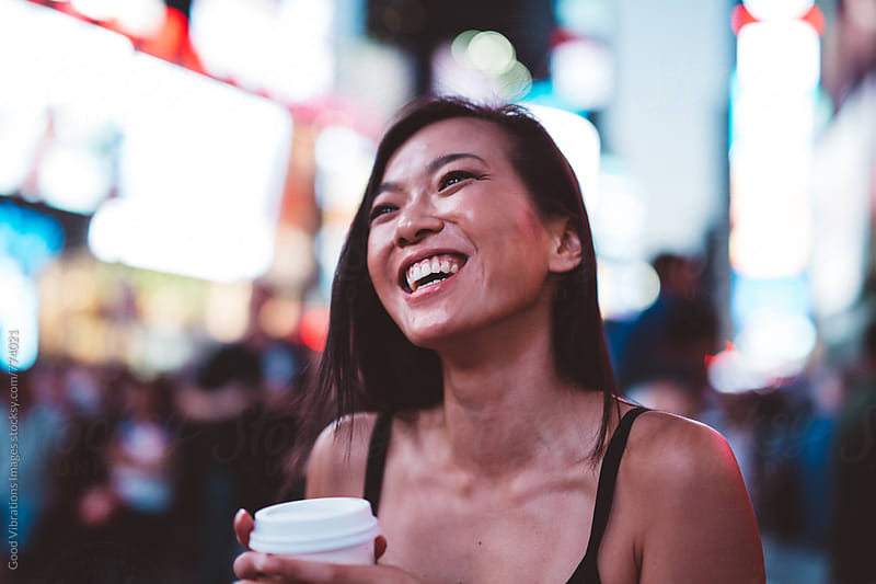 Asian Woman in Time Square in NYC by Good Vibrations Images for Stocksy United