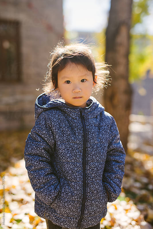 Toddler girl standing in autumn park by MaaHoo Studio for Stocksy United