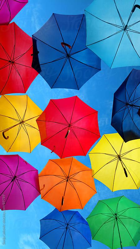 colorful umbrellas in the sky by Sonja Lekovic for Stocksy United