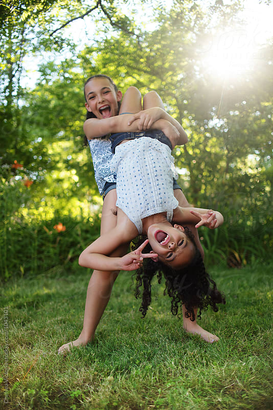 Young sisters playing outside in the summertime by Chelsea Victoria for Stocksy United