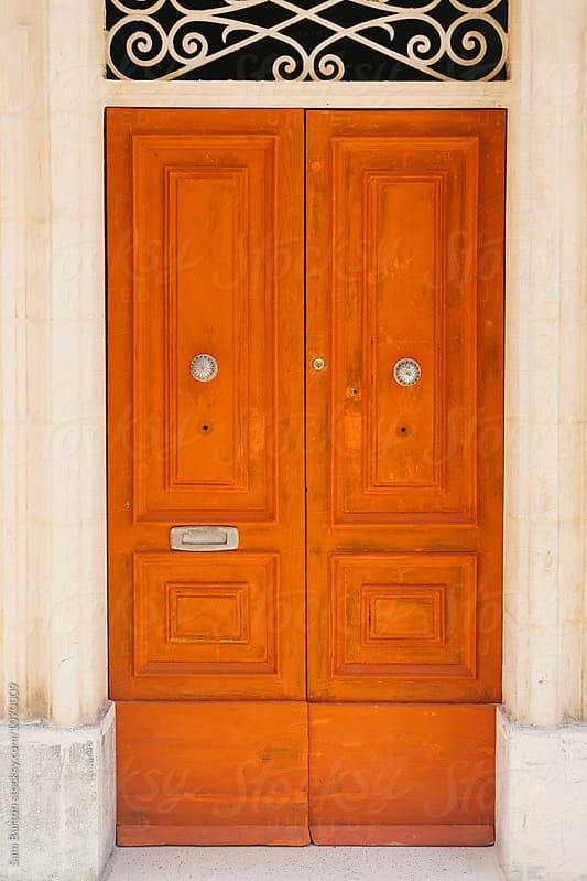 Orange door by Sam Burton for Stocksy United
