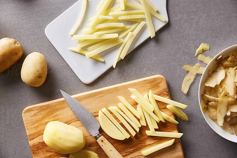 Fries potato on board by Martí Sans for Stocksy United