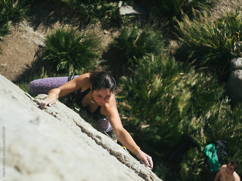 Fit girl  climber Climbing on el chorro rocks in spain by Martin Matej for Stocksy United