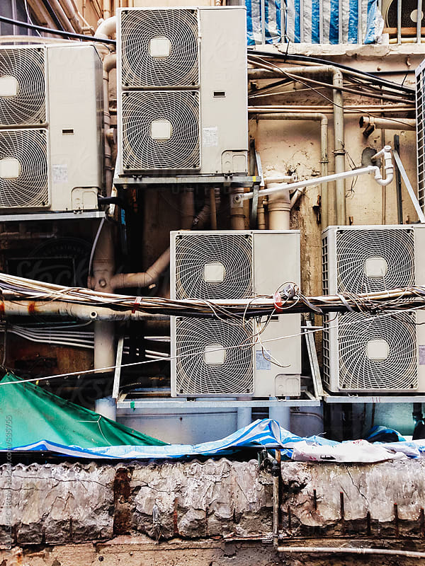 Air-Conditioning Units on Shabby Hong Kong Building by VISUALSPECTRUM for Stocksy United