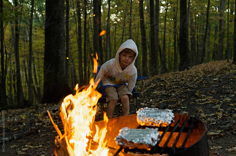Boy and Campfire by Ali Deck for Stocksy United