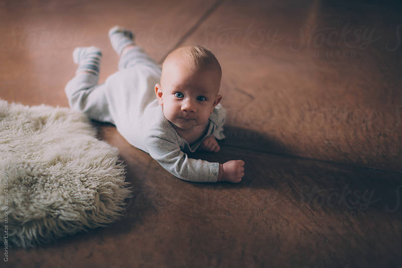Baby Crawling by Gabrielle Lutze for Stocksy United