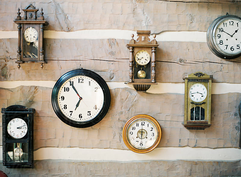 Clocks in a wood cabin by Vicki Grafton Photography for Stocksy United
