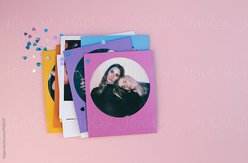 Polaroid print of best friends on a pink background with heart confetti by kkgas for Stocksy United