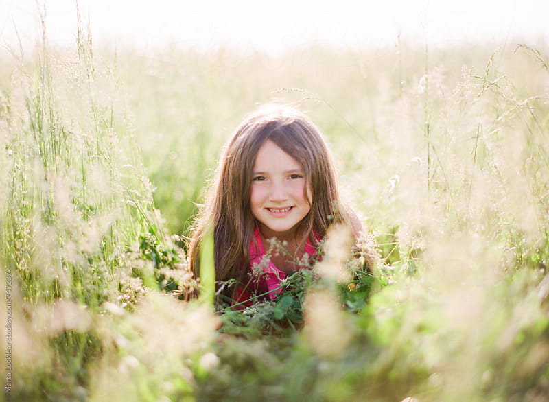 Girl in a field by Marta Locklear for Stocksy United