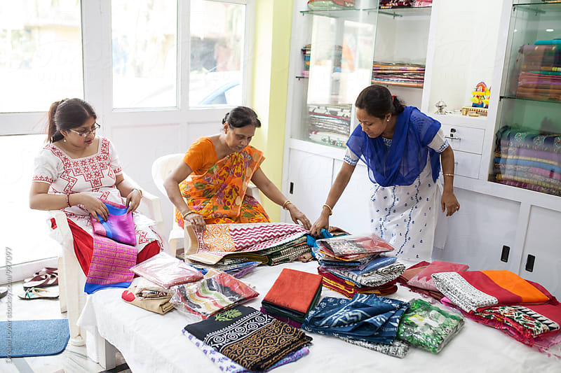 A Businesswoman who sells traditional Indian dress in a small shop by PARTHA PAL for Stocksy United