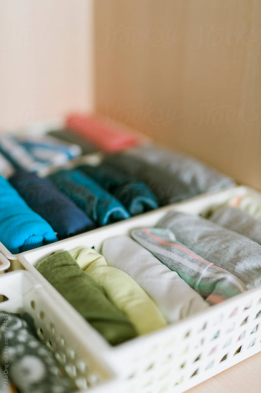 Neatly folded kid's clothing in wardrobe by Alita Ong for Stocksy United