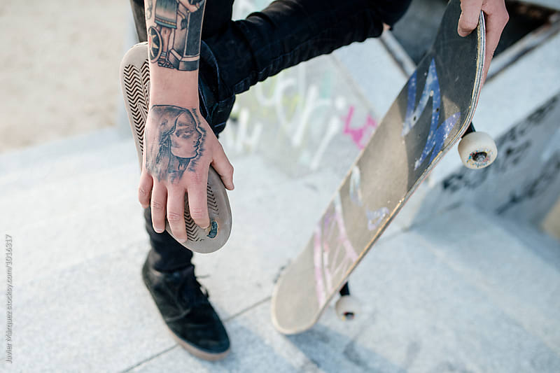 Young skater man with many tattoos.  by Javier Marquez for Stocksy United