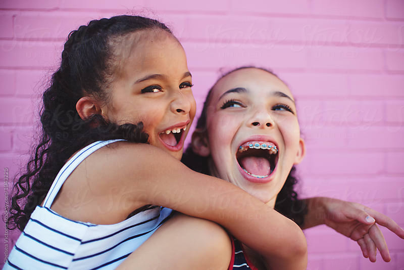 Two young sisters by Chelsea Victoria for Stocksy United