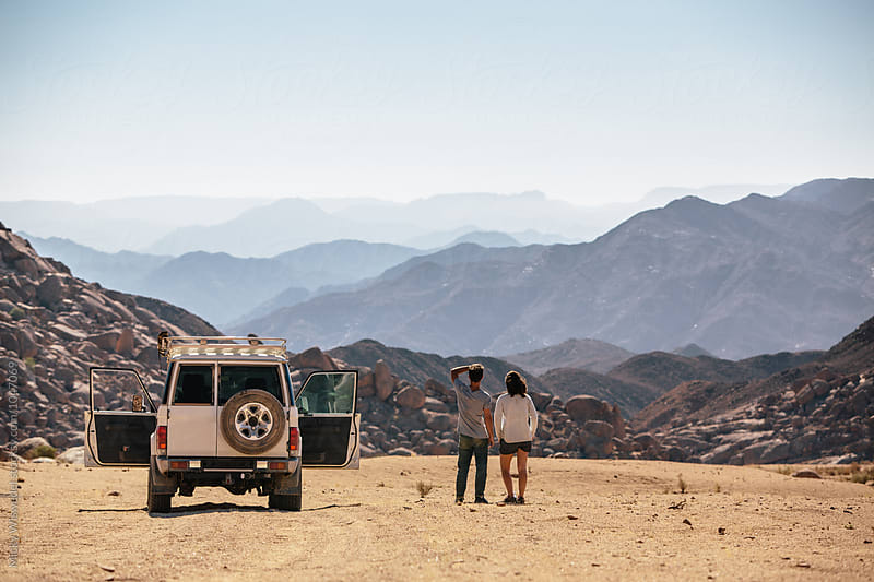 Outdoorsy couple on a roadtrip in the desert  by Micky Wiswedel for Stocksy United