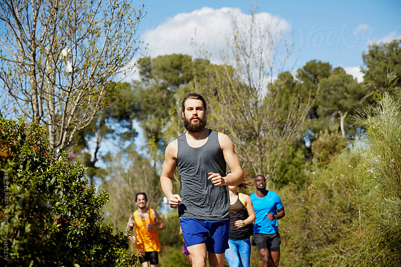 Fit Man With Friends Running On Sunny Day by ALTO IMAGES for Stocksy United