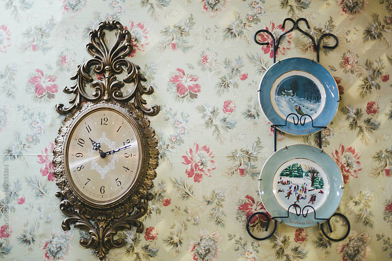 vintage clock and plates hanging on wall by Image Supply Co for Stocksy United