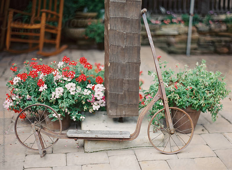 vintage scooter on a front porch  by Vicki Grafton Photography for Stocksy United
