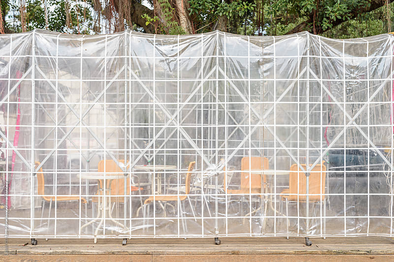 Empty summer cafe under transparent tent by Lawren Lu for Stocksy United