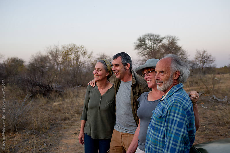 Friends enjoying the sunset by Bruce Meissner for Stocksy United