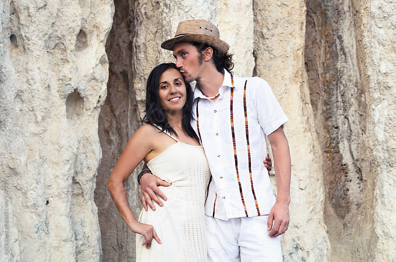 Hispanic-Caucasian couple portret on their wedding day by Alice Nerr for Stocksy United