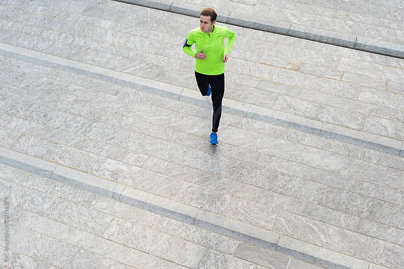 Runner training in the city by Simone Becchetti for Stocksy United
