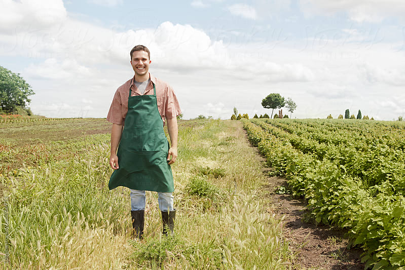 Smiling Farmer Next to His Vegetable Field by Lumina for Stocksy United