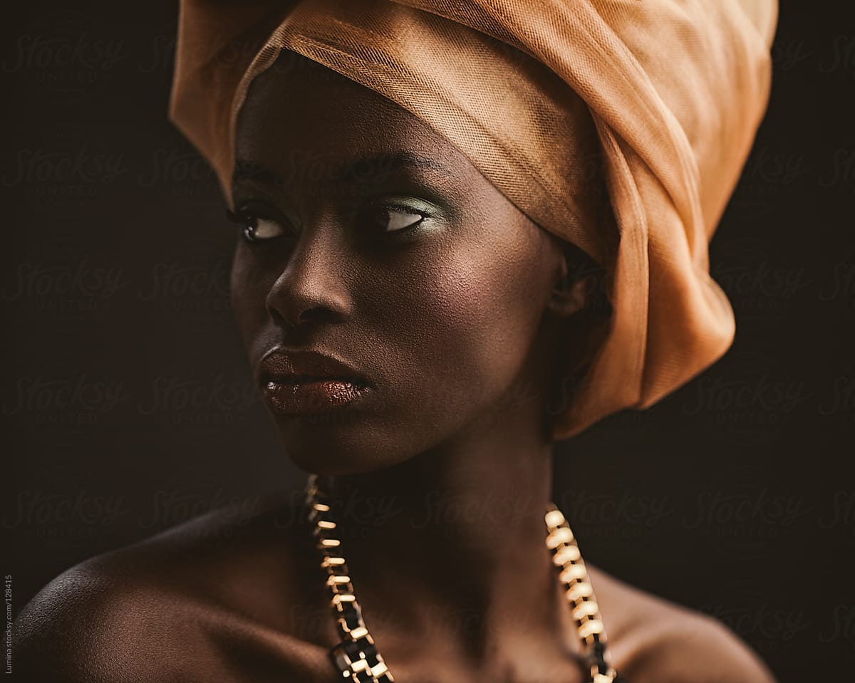 African Woman With An Orange Turban  Stocksy United-9573