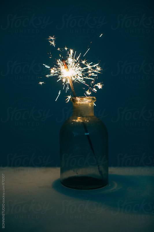 Sparkler burning in a jar. by BONNINSTUDIO for Stocksy United