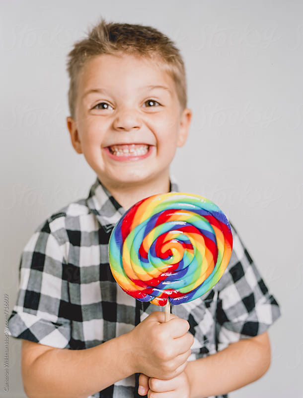 Super Excited Boy Gets A Sweet Treat by Cameron Whitman for Stocksy United