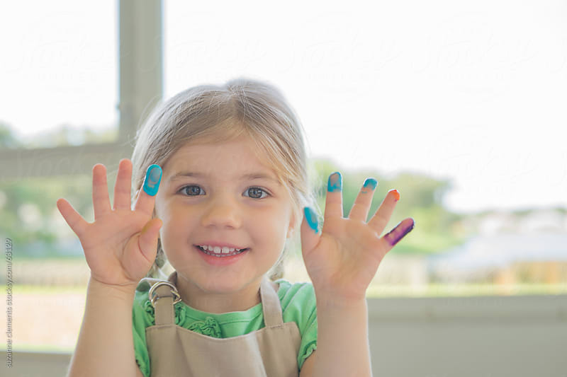 Creative Little Girl Plays With Color and Art by suzanne clements for Stocksy United