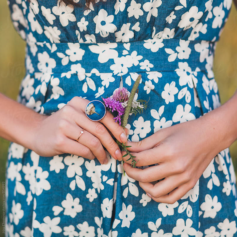 Female hands holding flowers by Irina Efremova for Stocksy United