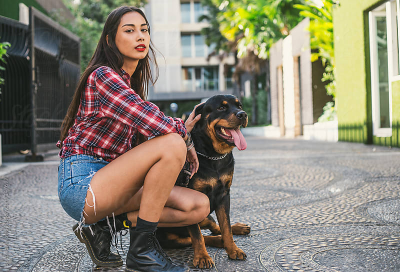 Beautiful young woman and her dog. by Jovo Jovanovic for Stocksy United