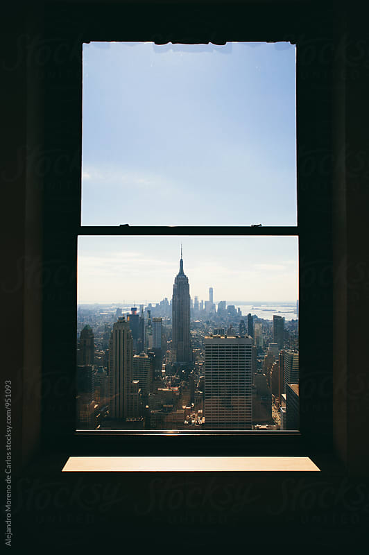View on New York through the window by Alejandro Moreno de Carlos for Stocksy United