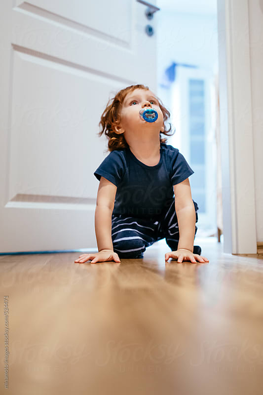 Toddler Escape On All Fours by minamoto images for Stocksy United