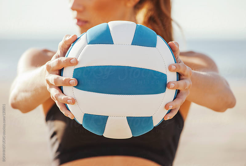 Beach volleyball. Close up of sporty woman showing a ball. by BONNINSTUDIO for Stocksy United