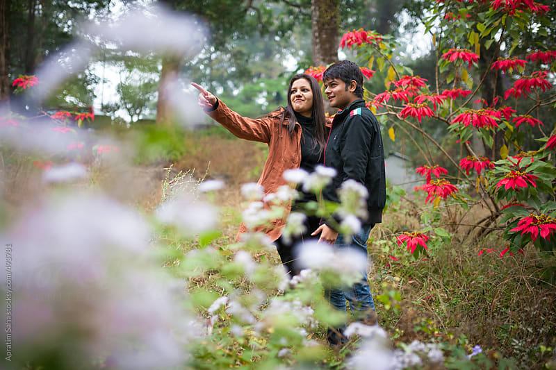 Young couple spending time together in a garden by Apratim Saha for Stocksy United