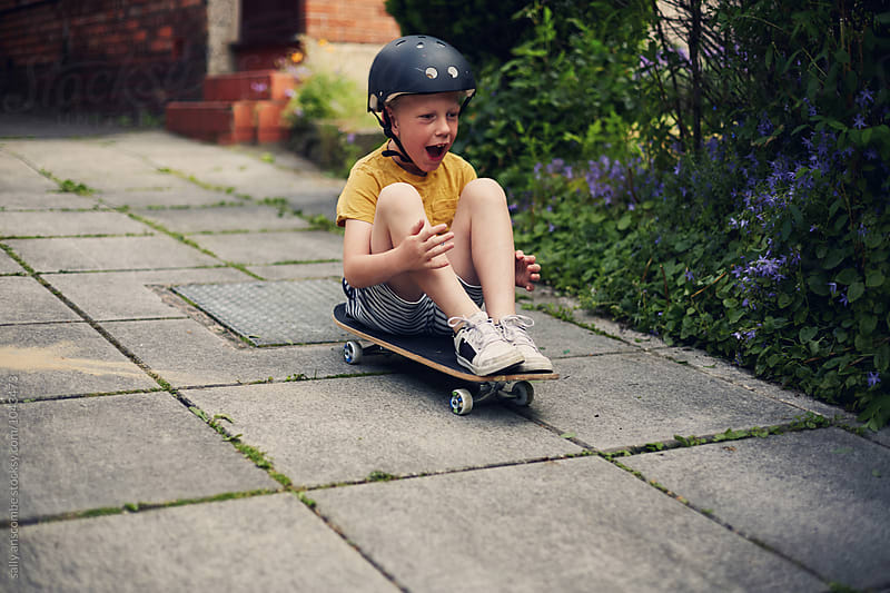 Child playing on a skateboard by sally anscombe for Stocksy United