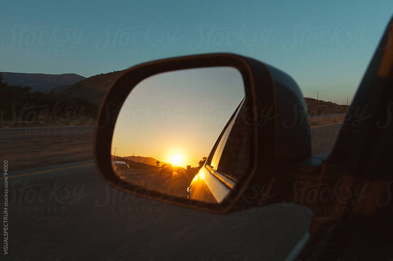 Sunset in Rear Mirror by VISUALSPECTRUM for Stocksy United