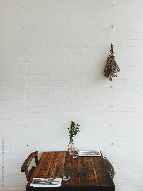 Set Table for Two in Rustic Restaurant by Julien L. Balmer for Stocksy United