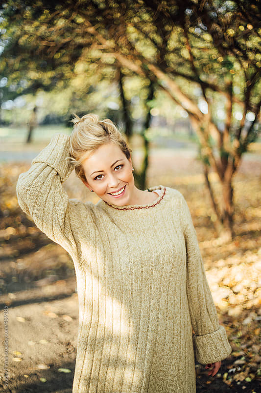 Potrait of a smiling blonde woman in the park . by Studio Firma for Stocksy United