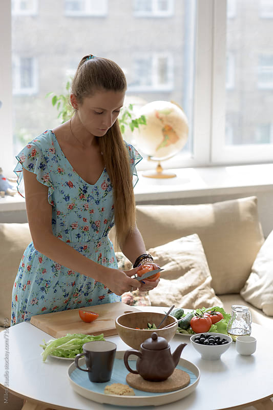 Woman cooking at home by Milles Studio for Stocksy United