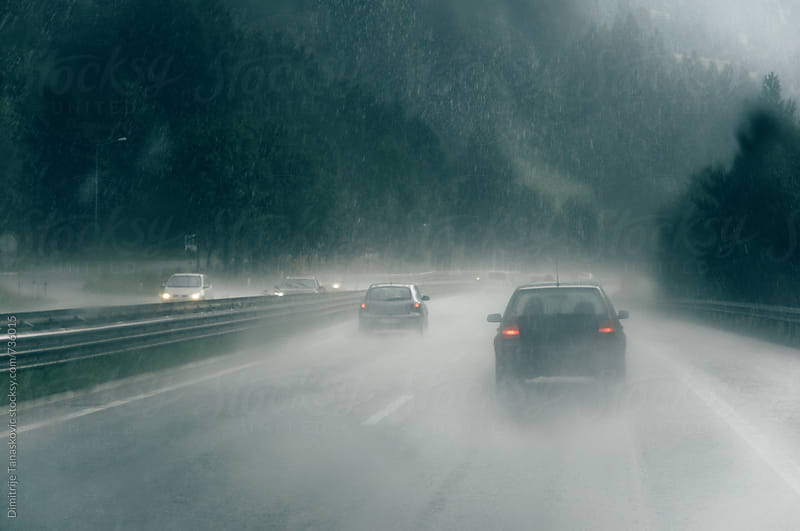 Heavy rain makes traffic jam on the highway by Dimitrije Tanaskovic for Stocksy United