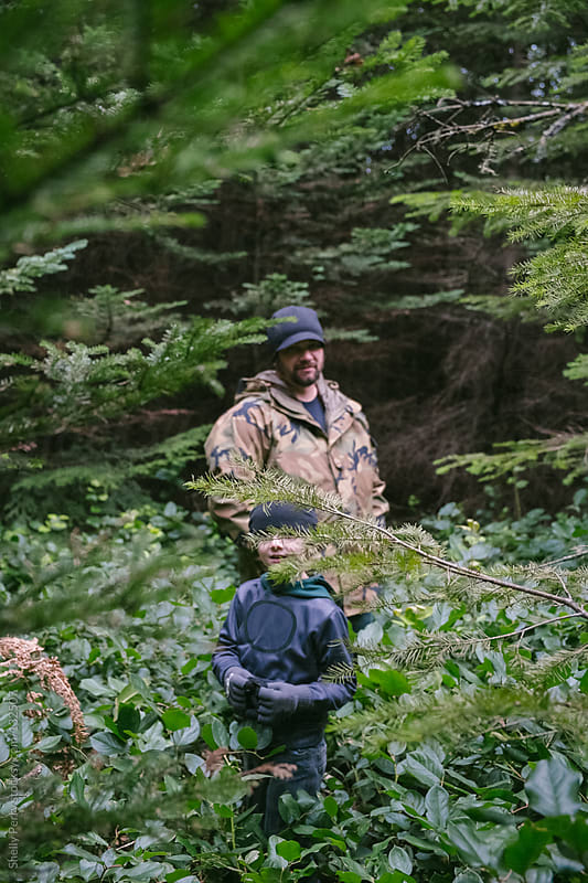 Father and son in nature by Shelly Perry for Stocksy United