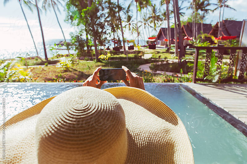 Woman Taking Holiday Photo with Smartphone by VISUALSPECTRUM for Stocksy United