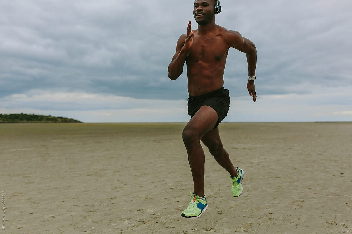 Young Black Man Running on the Beach by Mattia - Outdoor, Runner - Stocksy  United