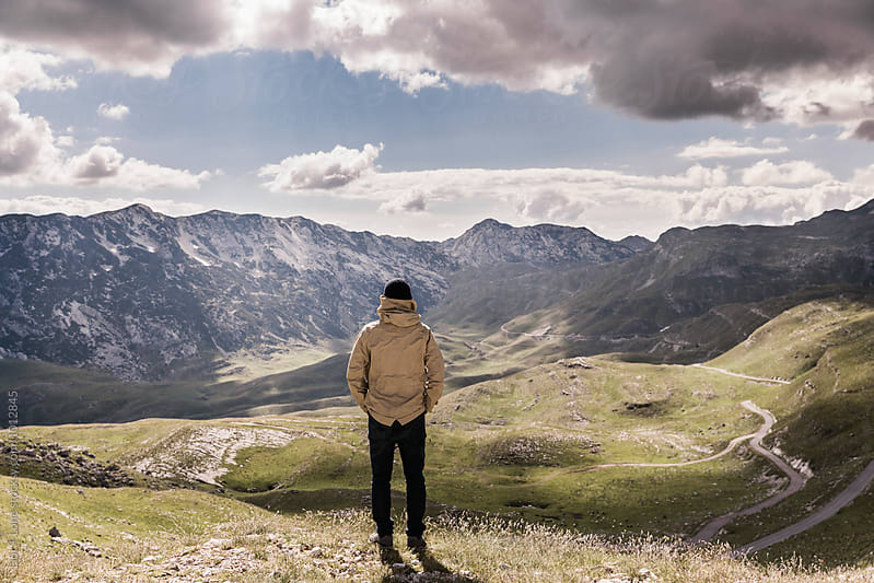 Man looking at green valley and mountains. Durmitor, Montenegro