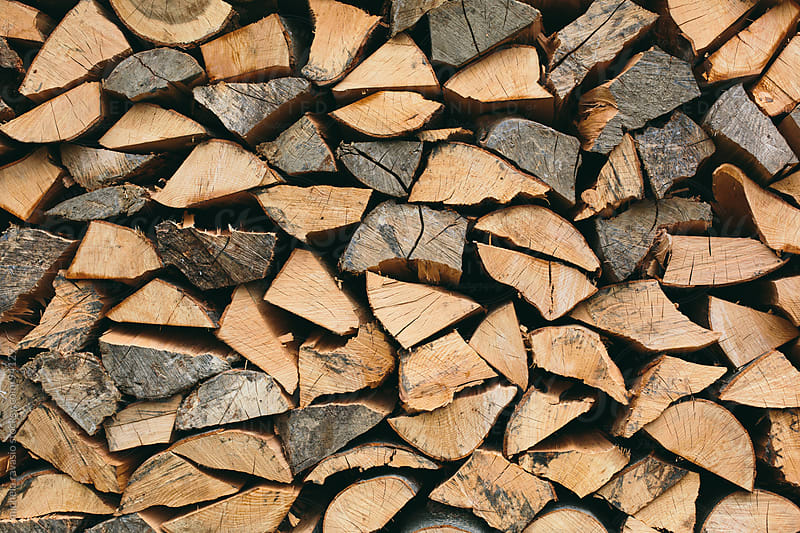 Stack of piled up fire wood by michela ravasio for Stocksy United